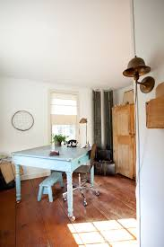 shy rabbit farm cottage chic home office photo in boston with white walls medium tone hardwood amazing wood office desk