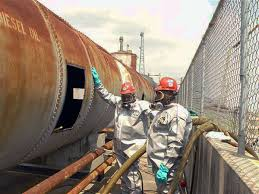 hulcher crew cleans the inside of a diesel oil tank as part of an above oil tank cleaning equipment
