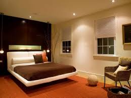 bedroom ball glass bulb hanging lamp ceiling lighting ideas brown head board wooden bed frames elegant bed lighting ideas