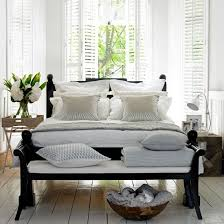relaxed neutral bedroom dark wood furniture against the white walls bedroom dark furniture