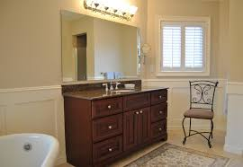 bright mirror lighting feat modern wooden bathroom vanity cabinets idea and wrought iron chair design simple designer bathroom vanity cabinets