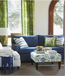 blue sofas living room: blue sofa green curtains amp patterned ottoman with fabric by calico corner blue sofas living roomgreen