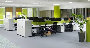 the bench desking in this open plan office is slightly screened from the main walkway by mid height storage units the lime green upholstered screens and accent office interiors
