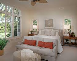 plantation shutter bedroom tropical with baseboards bedding bedside table carpet ceiling fan baseboards ceiling fan