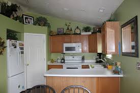 wall color ideas oak:  kitchen glamorous tiny area for simple kitchen paint colors with oak cabinets and white image of