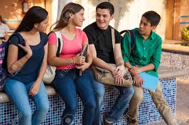 four high school friends backpacks and books hanging out four high school friends backpacks and books hanging out after school stock photo 29348186