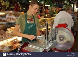 toronto ontario st lawrence market shopping vendor stock photo toronto ontario st lawrence market shopping vendor merchant deli counter meat carving machine slicer s clerk attenda