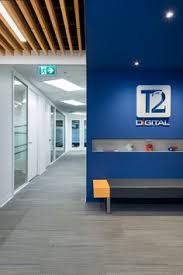 reception at t2 digital office interior design by ssdg interiors inc wood upholstered capital office interiors opening hours