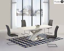 cream compact extending dining table: modern white high gloss extending dining table and grey chairs high gloss table