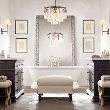 glamorous modern bathroom with bathroom lighting fixtures installed with white bathtub applying claw handle faucet and bathroom lighting fixtures