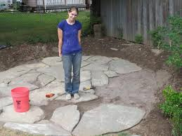 stone patio installation:  needed and exhaustion that resulted from moving flagstone for  hours over  consecutive days but it was a lot of fun and i have new tricep muscles