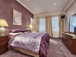 master bedroom feature wall:  master bedroom bedroom soft purple accent wall color with beige curtain for within master bedroom