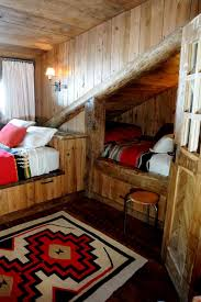 kids bedroom rustic gender neutral kids room idea in other with dark hardwood floors beds hideaway furniture ideas