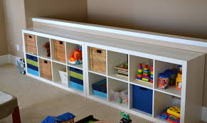 white storage unit wicker: storage units for kids rooms ideas with white wooden open shelves racks and rectangle table top