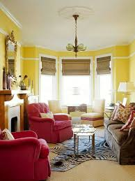 conquer a long narrow living room by breaking the space into two separate seating areas bhg living rooms yellow