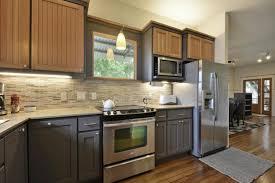 elegant kitchen design with two tone kitchen cabinets and mosaic tile backsplash with under cabinet lighting cabinet lighting backsplash home design