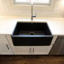 White Kitchen with <b>Gray and Black</b> Quartz Countertop and Bar Area ...