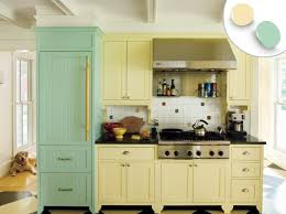 kitchen colors images: farmhouse style kitchen with pale yellow and green painted kitchen cabinets
