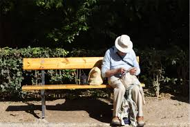 bored or broke in retirement these part time jobs might be for you old man in a hat sitting on a bench by himself