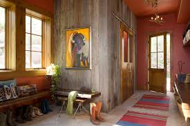 barn board siding entry rustic with animal painting antler chandelier image by studio 80 interior design chandelier barn board