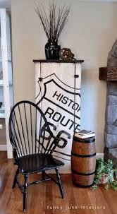 a cool route 66 themed cupboard on a rustic storage cabinet via funky junk interiors carolyn funky furniture