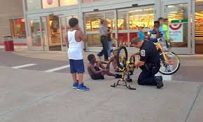 police officer caught fixing kid s bike gets the viral treatment cop fixing kid s bike is going viral for all the right reasons