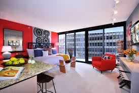aqua studio apartment example of a trendy bedroom design in chicago with red walls bca living room furniture