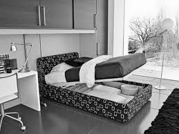 bedroom black blue wall paint colors artistic comic wardrobe cabinet white wooden bedside tables wheeled bed bedroom awesome black white bedrooms black