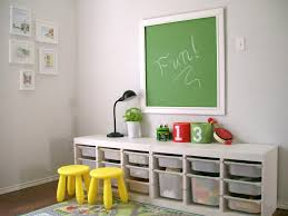 wonderful kids playroom design with white finish wooden storage cabinet which has plastic baskets plus two astounding picture kids playroom furniture