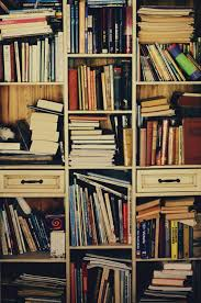 disordered books on shelves mean that they are being read bookcase book shelf library bookshelf read office