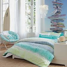 cool blue bedroom design in bright lighting with low hanging crystal chandelier shade and huge bay inspirational all white beach themed beach theme lighting