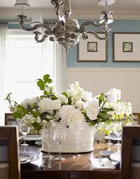 flower arrangements dining room table: white flower arrangement on dining room table