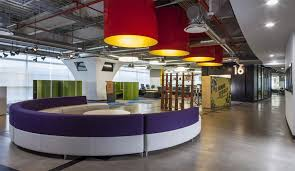 space arquitectura incorporated the same red from the grupo cp logo along with a host of other colours to create a dynamic office interior over three capital office interiors