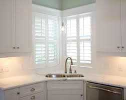 sink windows window love: plantation shutters on corner windows  plantation shutters on corner windows