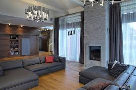amazing large living room interior with deluxe gray sofa set and fireplace along with stylish chandeliers awesome large living room