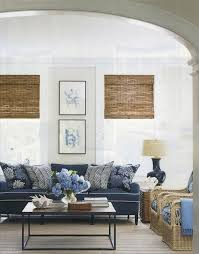 blue sofas living room: blue and white family room with seacloth pillows and quadrille zig zag pillows on a blue