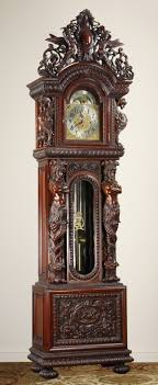 Carved mahogany figural tall case clock, after R.J. Horner, with ...
