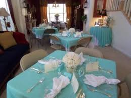 Breakfast at Tiffany bridal shower decorm blue table cloths, white napkins and centrepieces