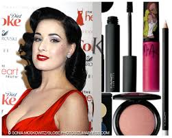von teese works a red lip in a far more striking manner than bryant the results a flawless face focused on a matte red lip acpanied by major makeup