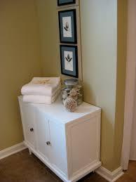 bay corner linen cabinet cabinets corner  interior furniture bathroom white towel on small white wooden
