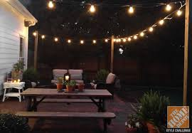 wooden posts used to hang string lights on a deck backyard lighting ideas