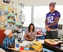 rudolph steps into new lead volunteer role the vikings vikings vikings tight end kyle rudolph shown above a family at the u s children s hospital said his s are about bringing a little bit of joy to