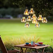 backyard party lighting ideas lanterns chandeliers and string lights add magic to evenings outside backyard party lighting ideas