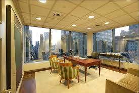the ceos sparten corner office at 535 madison avenue with interior lighting and a north ceo office