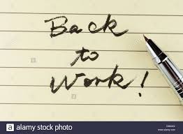 back to work words written on lined paper a pen on it stock back to work words written on lined paper a pen on it
