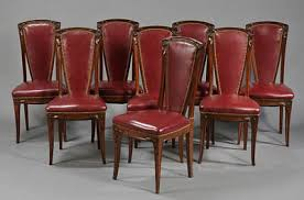 set of eight french art nouveau period tall back dining chairs in solid carved walnut in the manner of louis majorelle with carved floral crest art deco dining chair