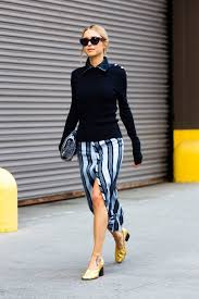 13 stylish and professional outfits to wear on a job interview cold weather winter interview outfit sweater striped silk skirt