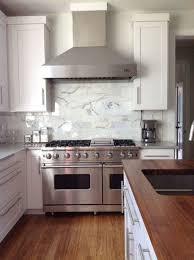 kitchen design ideas island smart  white marble mosaic kitchen backsplash brown stain wall