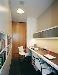 soho loft office example of a small trendy home office design in new york with beige beautiful home office wall