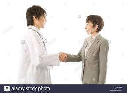 doctor and pharmaceutical s representative shaking hands stock doctor and pharmaceutical s representative shaking hands